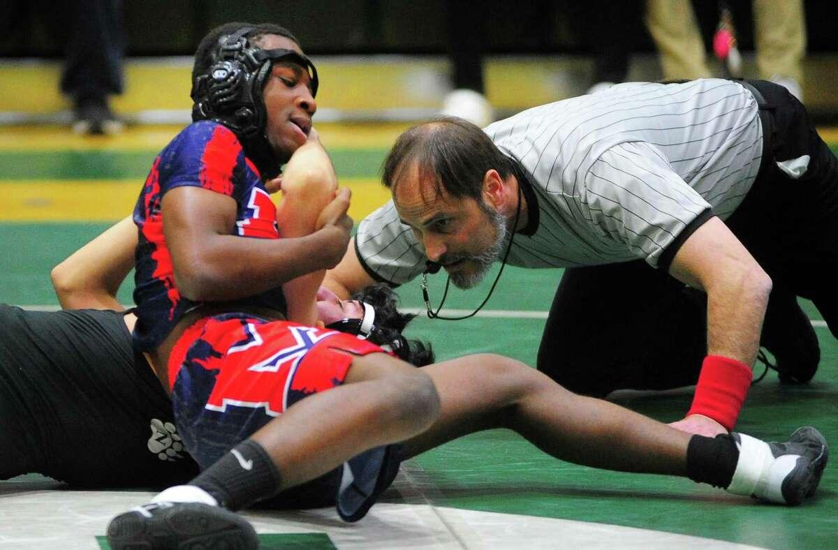 Brien McMahon's Jonathan Jean works to pin Norwalk's Esteban Vega during high school wrestling action in Norwalk, Conn., on Wednesday Feb. 5, 2020.