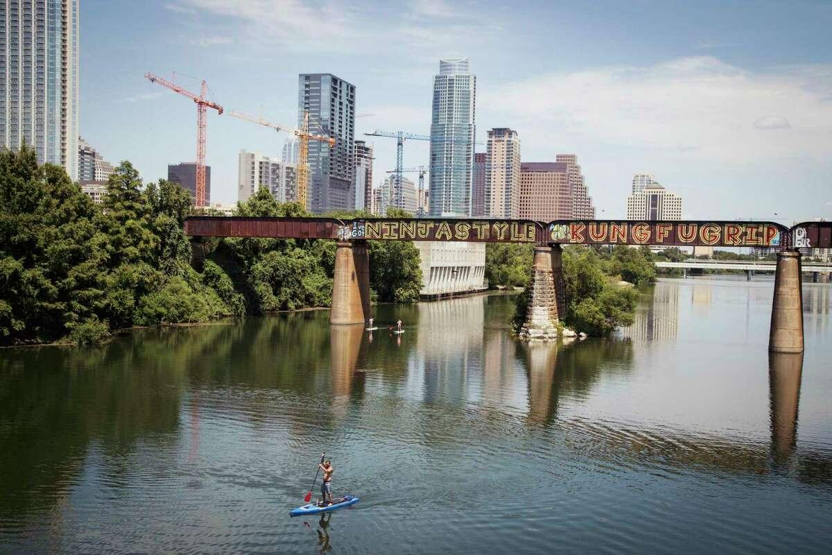 "View of downtown Austin, Texas from Lamar Pedestrian Bridge showing the ""I've got Ninja Style Kung Fu Grip"" graffiti."