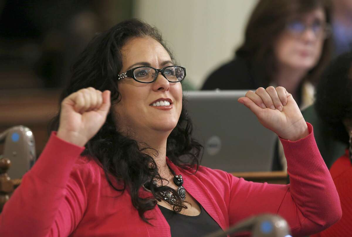 Assemblywoman Lorena Gonzalez, D-San Diego, celebrates after a bill raising the the smoking age from 18 to 21, was approved by the Assembly, Thursday, March 3, 2016, in Sacramento, Calif. The bill, by Assemblyman Jim Wood, D-Healdsburg, was part of a package of bills aimed at restricting access to tobacco, now goes to the Senate.(AP Photo/Rich Pedroncelli)