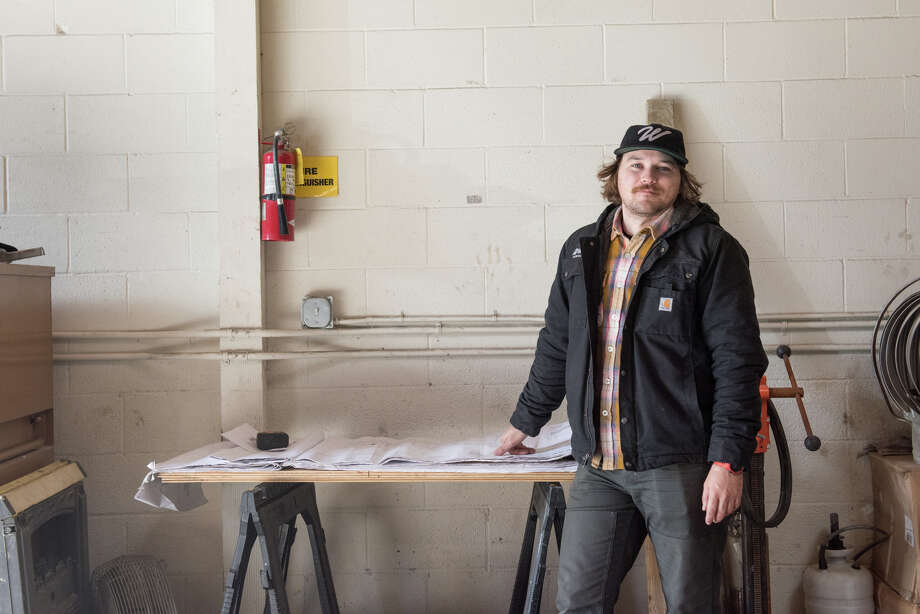 Wynn Whisenhunt, founder and brewer at Wondrous Brewing in Emeryville, Calif. Stands in front of the blueprints for the new space. Scroll ahead for more photos of the construction of Wondrous Brewing. Photo: Blair Heagerty / SFGate