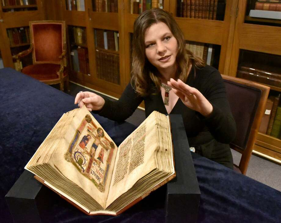 Lynley Herbert, Curator of Rare Books and Manuscripts at the Walters Art Museum, discusses a legendary item in their collection, the St. Francis Missal from Italy, circa 1200, which is once again accessible after the museum undertook a two-year conservation project. Photo: Amy Davis, MBR / TNS / Baltimore Sun