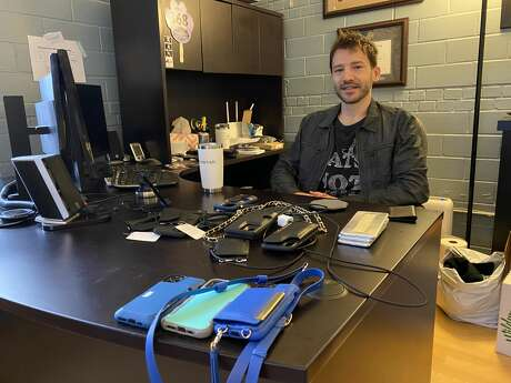 """Smartish President and CEO Matt Altschul is shown in his office in Austin on Jan. 21, 2020. Altschul, whose business card describes him as the """"CEOish"""", designed a smartphone case specifically to capture the top recommendation for the New York Times' Wirecutter product review site - and it worked."""