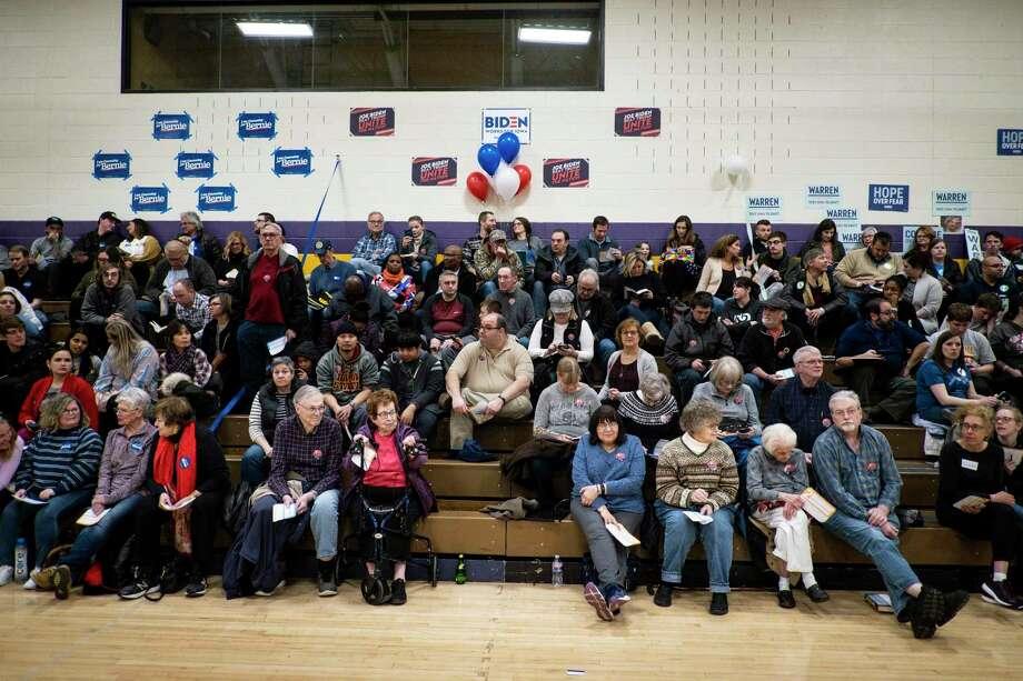 Iowa caucus participants gather in Johnston on Monday.  A reader says the delay in reporting the results could have been solved with one phone call. Photo: Pete Marovich /New York Times / NYTNS
