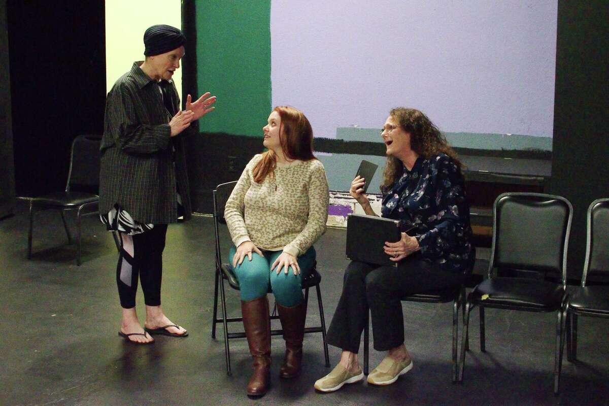 Deborah Winters, Brandee Sibley and Teresa McLemore rehearse a scene from