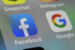 (FILES) In this file photo taken on October 01, 2019 a picture taken on October 1, 2019 in Lille shows the logos of mobile apps Facebook and Google displayed on a tablet. - More than 100 child protection organizations February 6, 2020 urged Facebook to halt plans for strong encryption of all its platforms, saying that would allow predators to operate freely. The social network is working to extend end-to-end encryption across its messaging applications, including Facebook Messenger and Instagram. (Photo by DENIS CHARLET / AFP) (Photo by DENIS CHARLET/AFP via Getty Images)