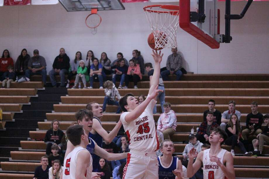 Quinn Zickert drops in a layup from the low post as part of a 19-point effort against Kalkaska. Photo: Robert Myers