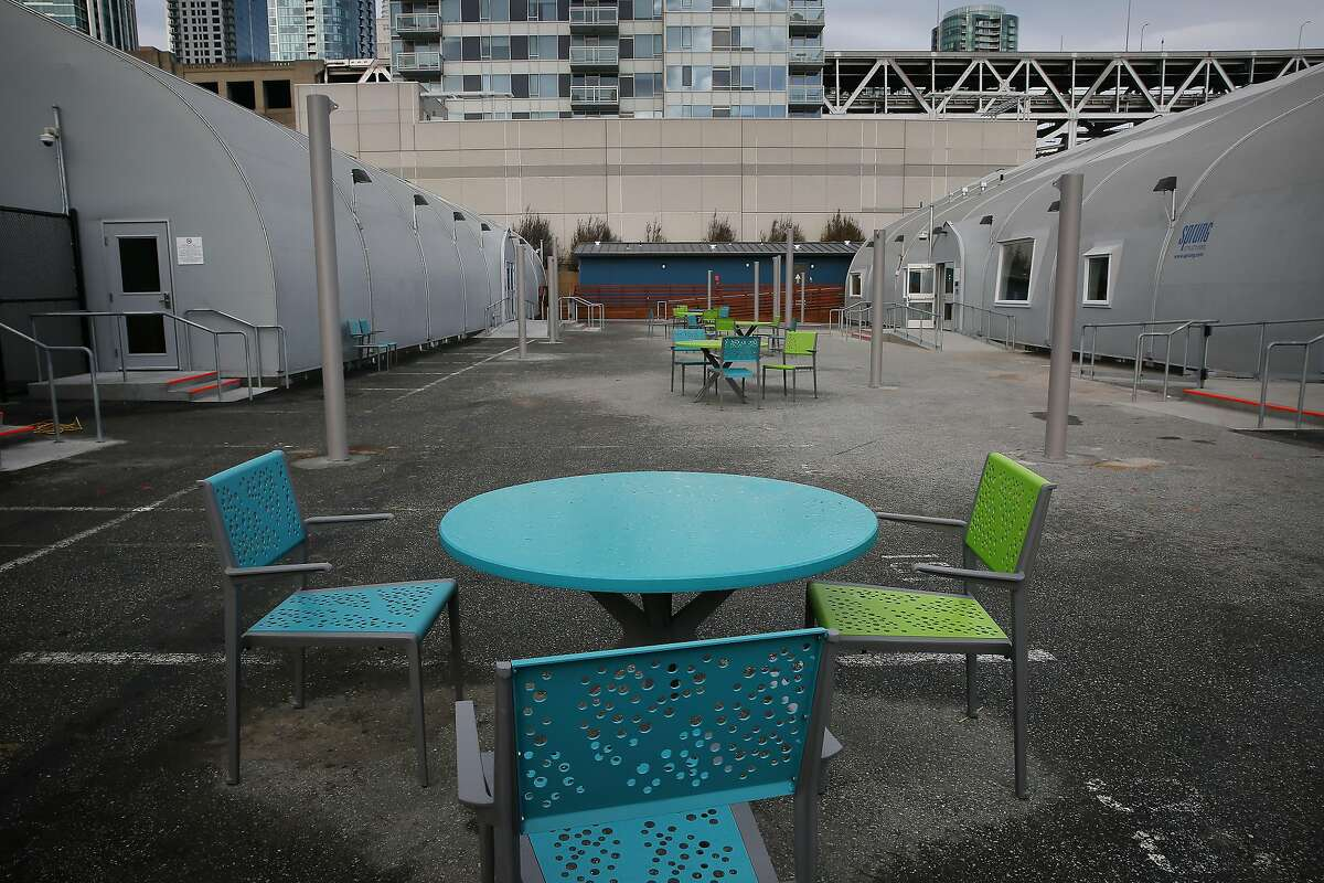 Tables and chairs are seen in the large central courtyard at the Embarcadero Safe Navigation Center on Wednesday, January 8, 2020 in San Francisco, Calif.