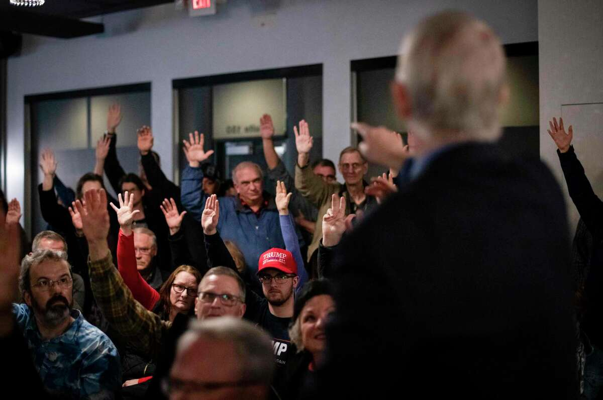 Caucusgoers are counted at a Republican caucus location at the Butcher Block Steakhouse in Cedar Rapids, Iowa, Feb. 3, 2020. In the state?•s noncompetitive Republican contest, President Trump?•s true believers dominated school gyms, churches and other caucus sites. (Christian Monterrosa/The New York Times)