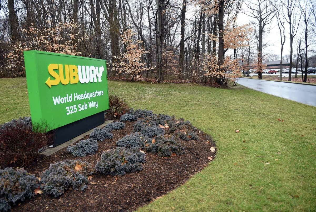 A sign for the Subway World Headquarters in Milford