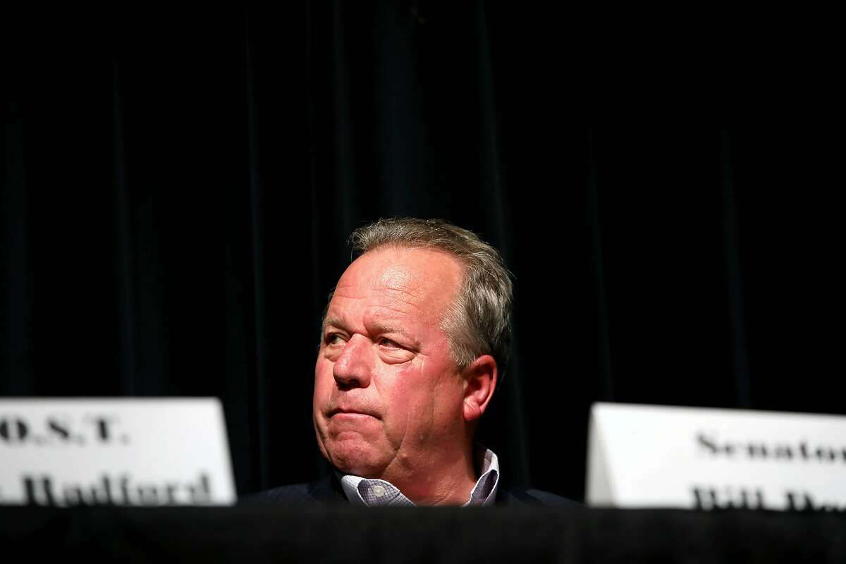 """Senator Bill Dodd listens to a speaker during a town hall meeting called, """"Seeking Solutions: A Community Policing Forum,"""" at Vallejo High School, in Vallejo, Calif., on Saturday, September 7, 2019."""