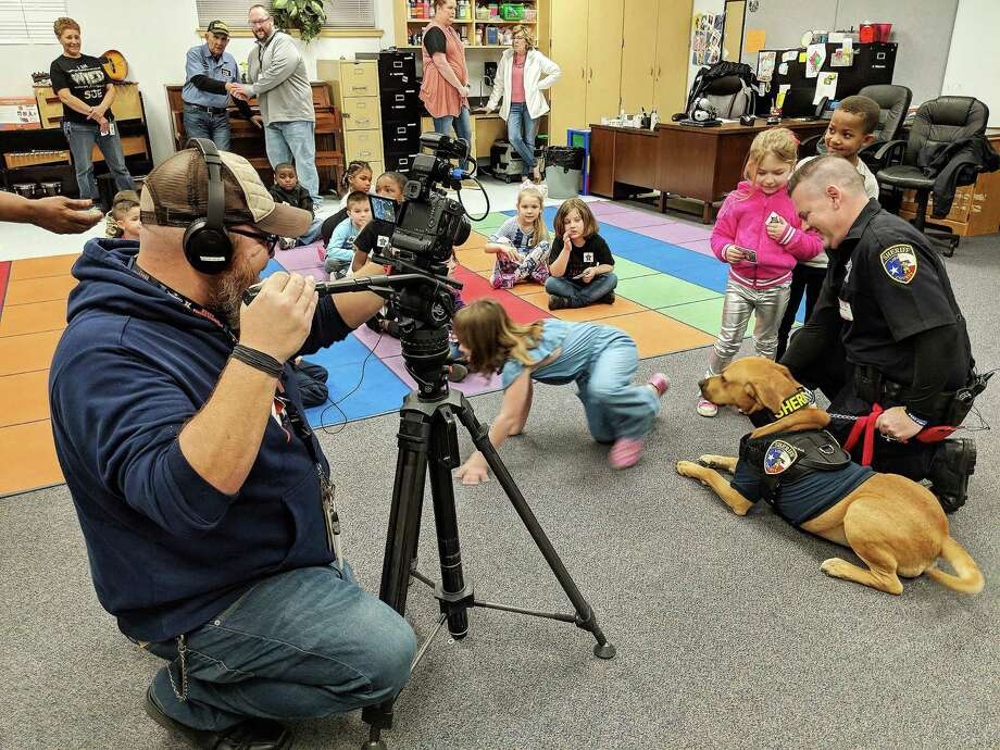 Liberty County Sheriff's Office Deputy K-9 Red recently visited San Jacinto Elementary school in Liberty ISD and 80 kindergarteners and first grader's fell in love. The children, who lavished praise and adoration on the K-9, also hugged and petted the receptive Red for all of two hours. Photo: Submitted
