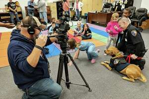 Liberty County Sheriff's Office Deputy K-9 Red recently visited San Jacinto Elementary school in Liberty ISD and 80 kindergarteners and first grader's fell in love. The children, who lavished praise and adoration on the K-9, also hugged and petted the receptive Red for all of two hours.