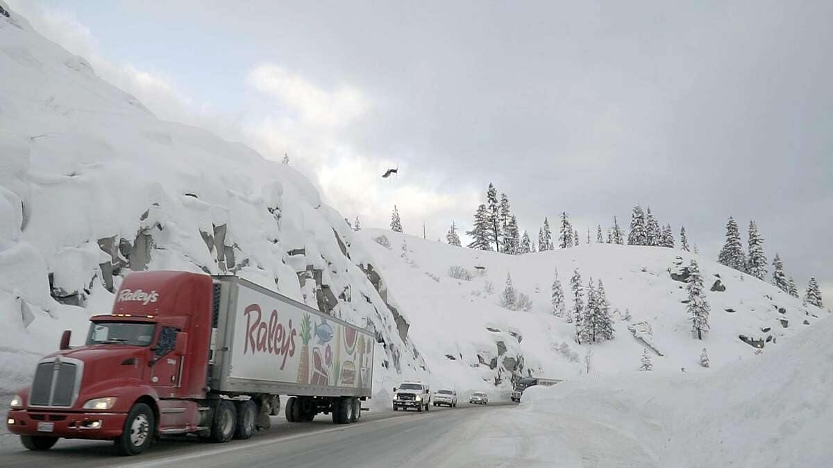 Skier Josh Daiek coming into a backflip on his first ski-jump over Highway 50 near South Lake Tahoe. ONE TIME USE