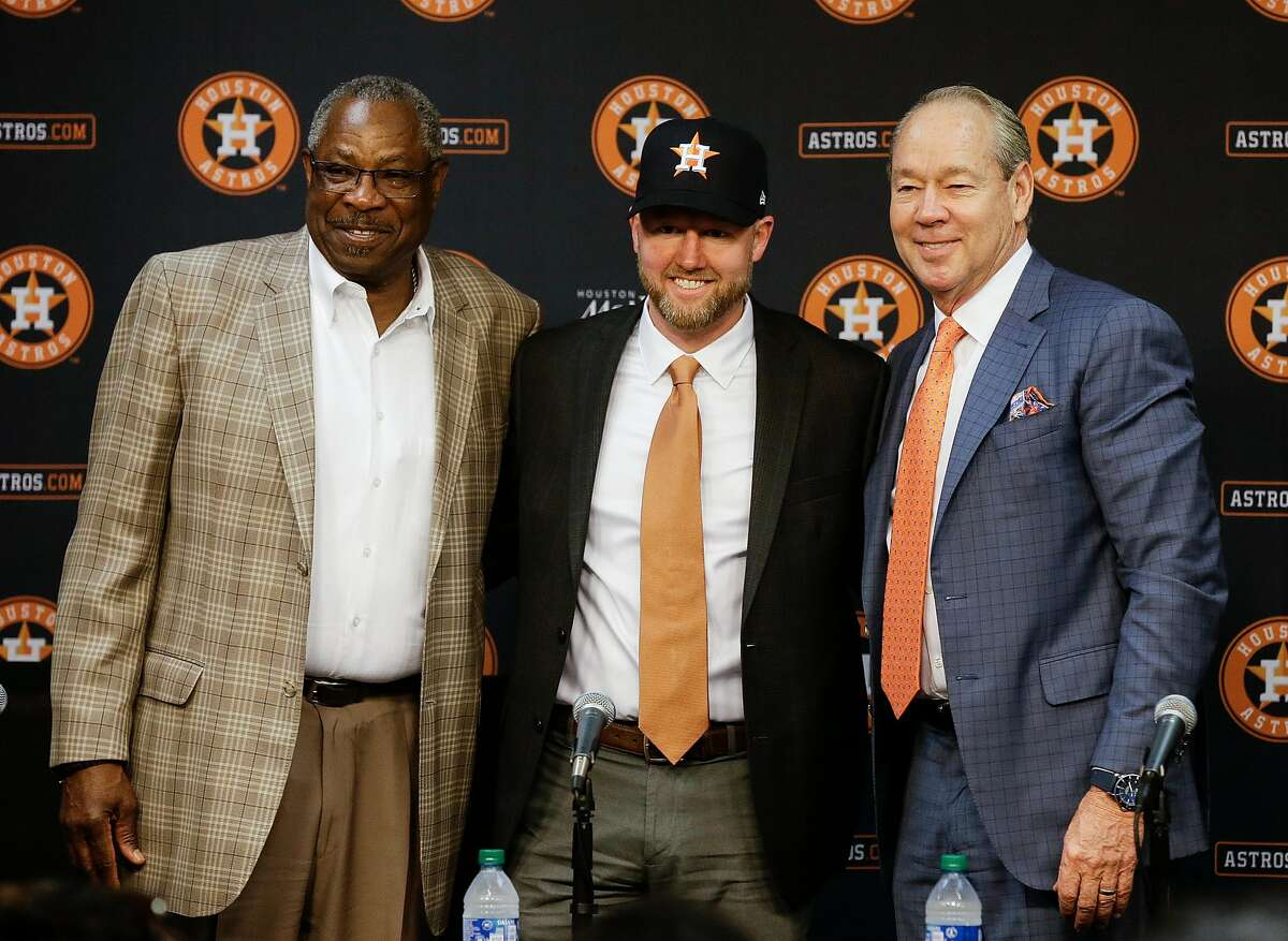 HOUSTON, TEXAS - FEBRUARY 04: Houston Astros manager Dusty Baker, left, Houston Astros General Manager James Click and Houston Astros owner Jim Crane introducing Click as the new general manager dy=uring a press conference at Minute Maid Park on February 04, 2020 in Houston, Texas. (Photo by Bob Levey/Getty Images)