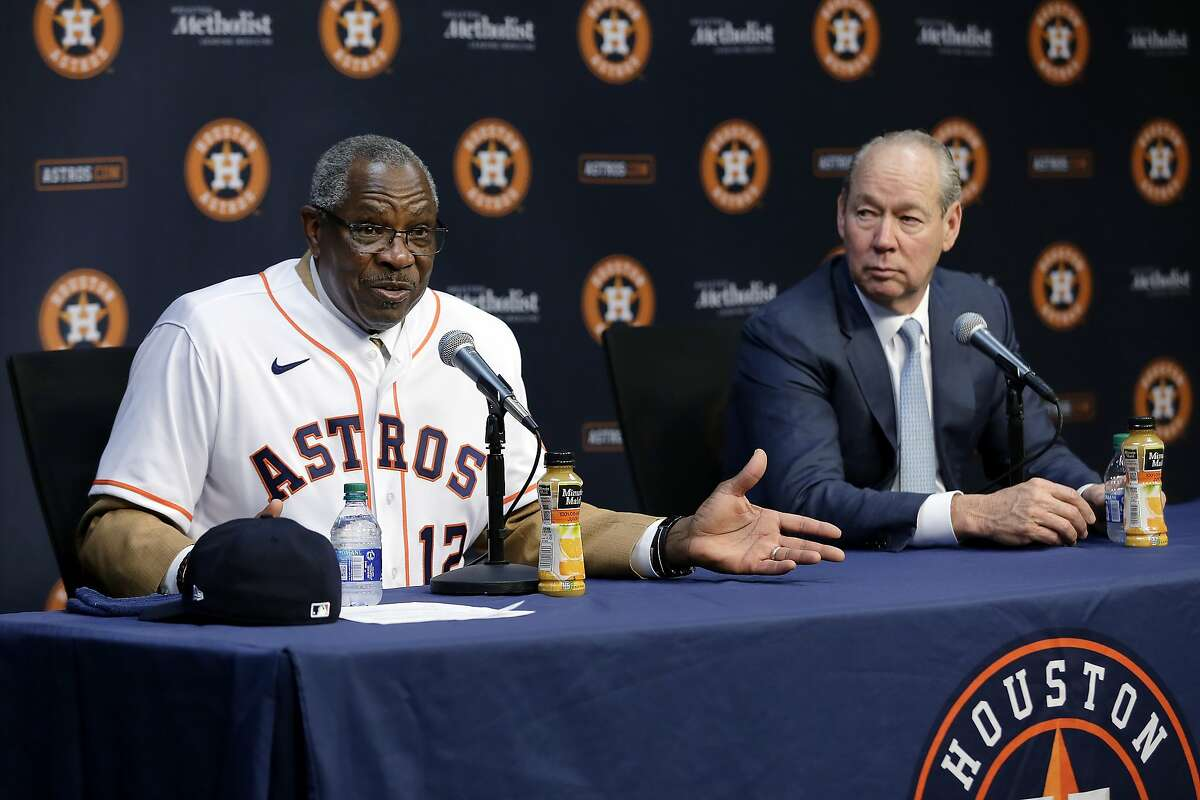 Dusty Baker, left, and team owner Jim Crane, right, speak during a press conference formally naming Baker as the new manager of the Houston Astros in the interview room at Minute Maid Park Thursday, Jan. 30, 2020, in Houston. (AP Photo/Michael Wyke)