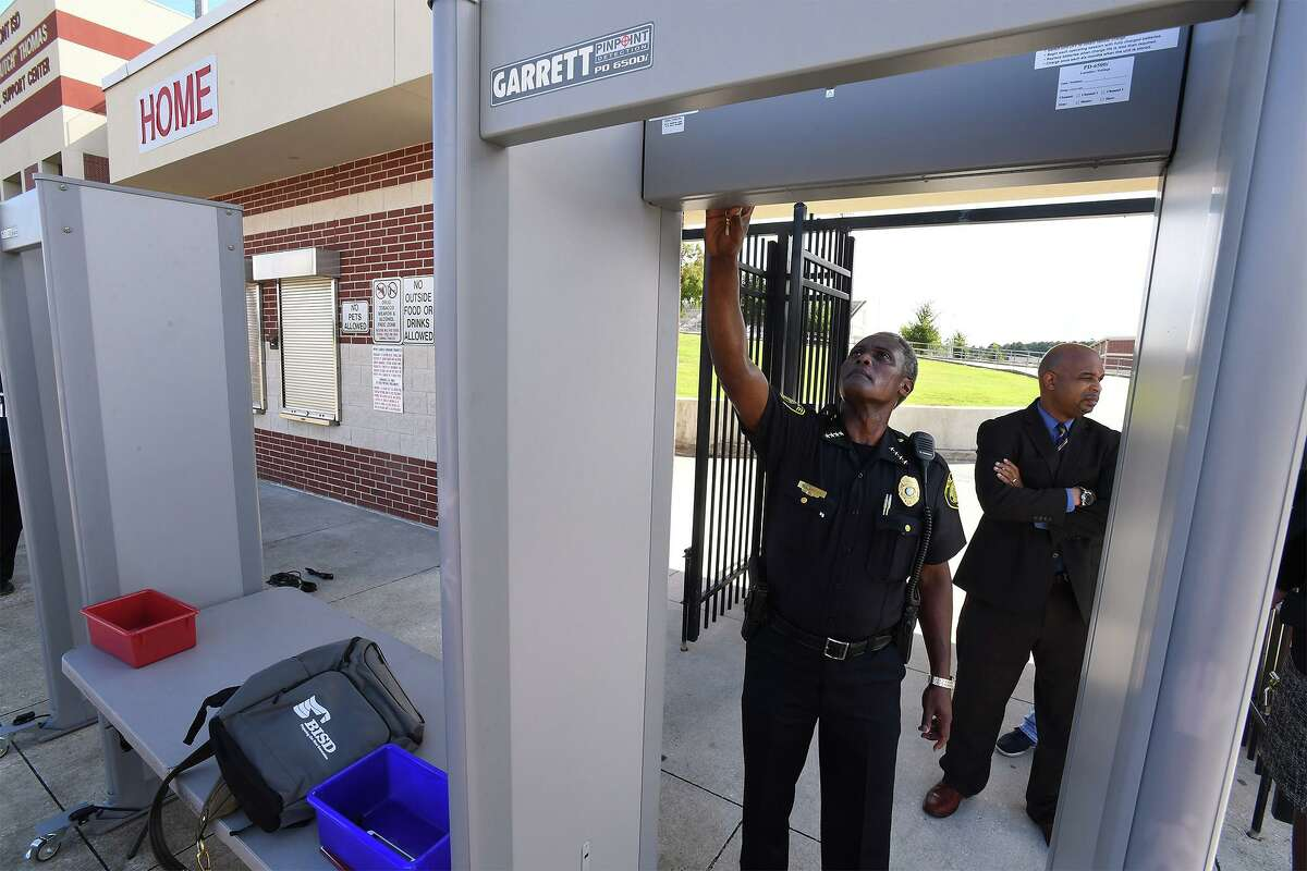 Joseph Malbrough police chief for the Beaumont Independent School District adjusts a metal detector in front of the district's football stadium during a press conference on Monday. The detectors will be used for large events and are the first to be used for high school sports in the area. Photo taken Monday, 8/27/18