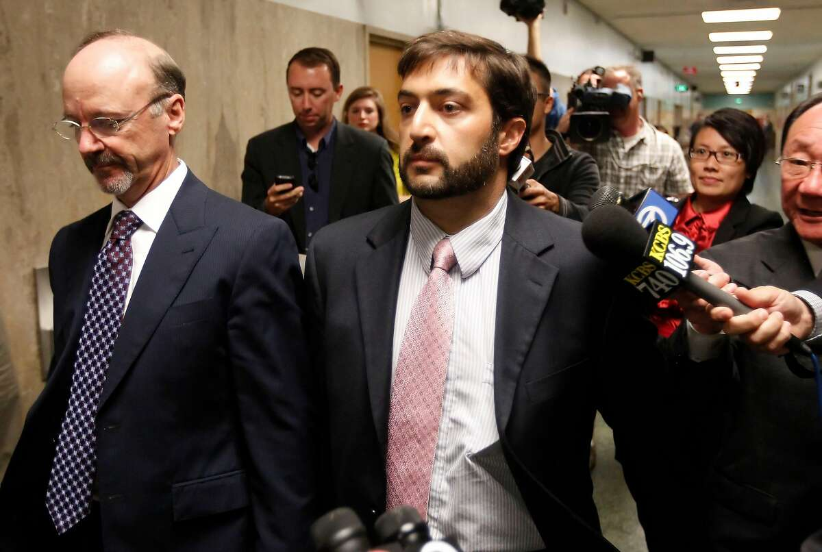 Christopher Bucchere, 37, leaving court with his attorney Ted Cassman, (left) after his sentencing on Thursday August 15, 2013, in San Francisco, Ca. Bucchere pled guilty to vehicular manslaughter, the first of its kind in the nation involving a bicycle.
