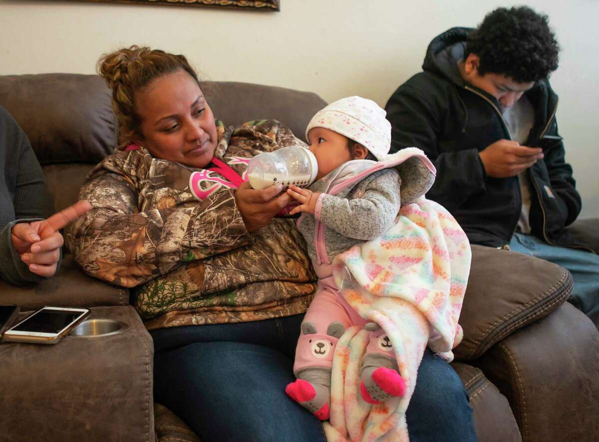 Chrisanta Orta holds her baby, Jenicka, who was born on the same day as Ricardo Escobar Jr., who was killed in a car crash along with his mother and grandmother Tuesday afternoon, Thursday, Feb. 6, 2020, at the home of Diana Soriano-Escobar and Ricardo Escobar in south Houston. Orta was friends with Diana Soriano-Escobar, and the friends shared a joint baby shower for their two children. Family friends have been sitting in vigil for the family.