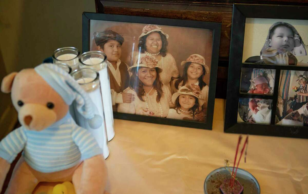 A picture of Piedad Romero, who died in a fatal crash Wednesday afternoon in north Houston, along with in a her daughter, Diana Soriano-Escobar, who was also killed, and Piedad's youngest daughter, Valeria Soriano (bottom right), who was injured in the crash, sits on a table next to a picture of Diana's son, Ricardo Jr., Thursday, Feb. 6, 2020, at the home of Diana Soriano-Escobar and Ricardo Escobar in south Houston. Friends have constructed a temporary altar in the home to honor Piedad, Diana and Ricardo Jr., who all died when they were hit by another car.