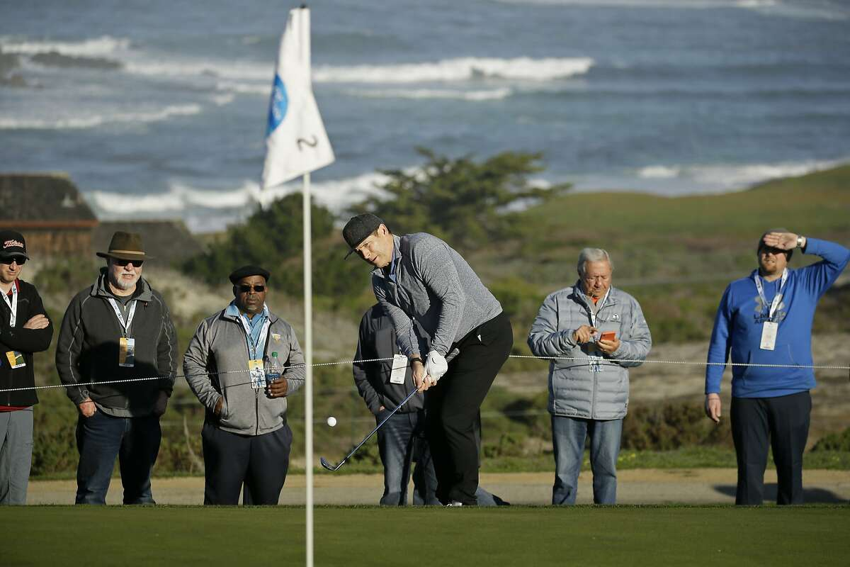 Steve Young chips the ball up to the second green of the Spyglass Hill Golf Course during the first round of the AT&T Pebble Beach National Pro-Am golf tournament Thursday, Feb. 6, 2020, in Pebble Beach, Calif. (AP Photo/Eric Risberg)