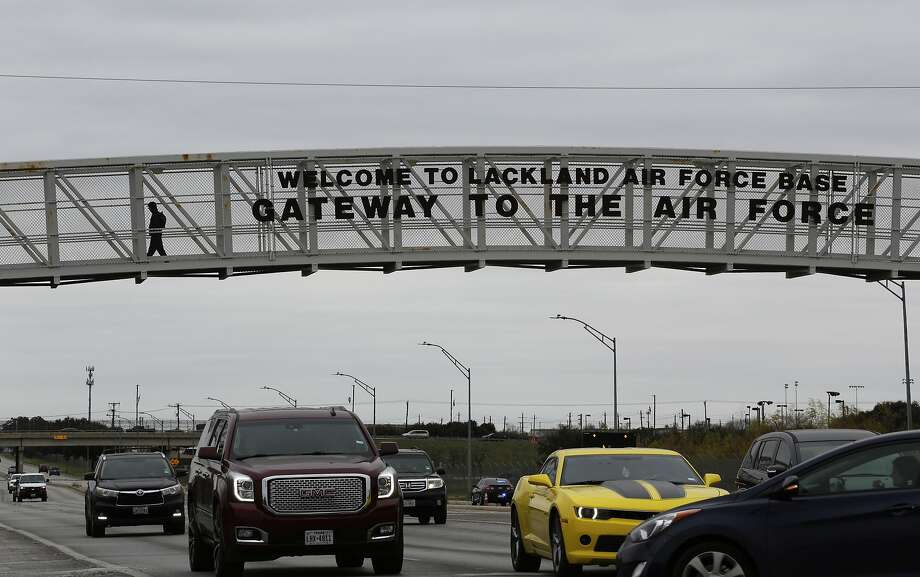 A pedestrian uses a walkway at the main gate at Lackland Air Force Base in San Antonio, Wednesday, Feb. 5, 2020. Several planes carrying U.S. citizens fleeing the virus zone in Wuhan China will arrive at Air Force bases including Joint Base San Antonio-Lackland, where they will be quarantined for up to 14 days, according to the CDC. (AP Photo/Eric Gay) Photo: Eric Gay, Associated Press