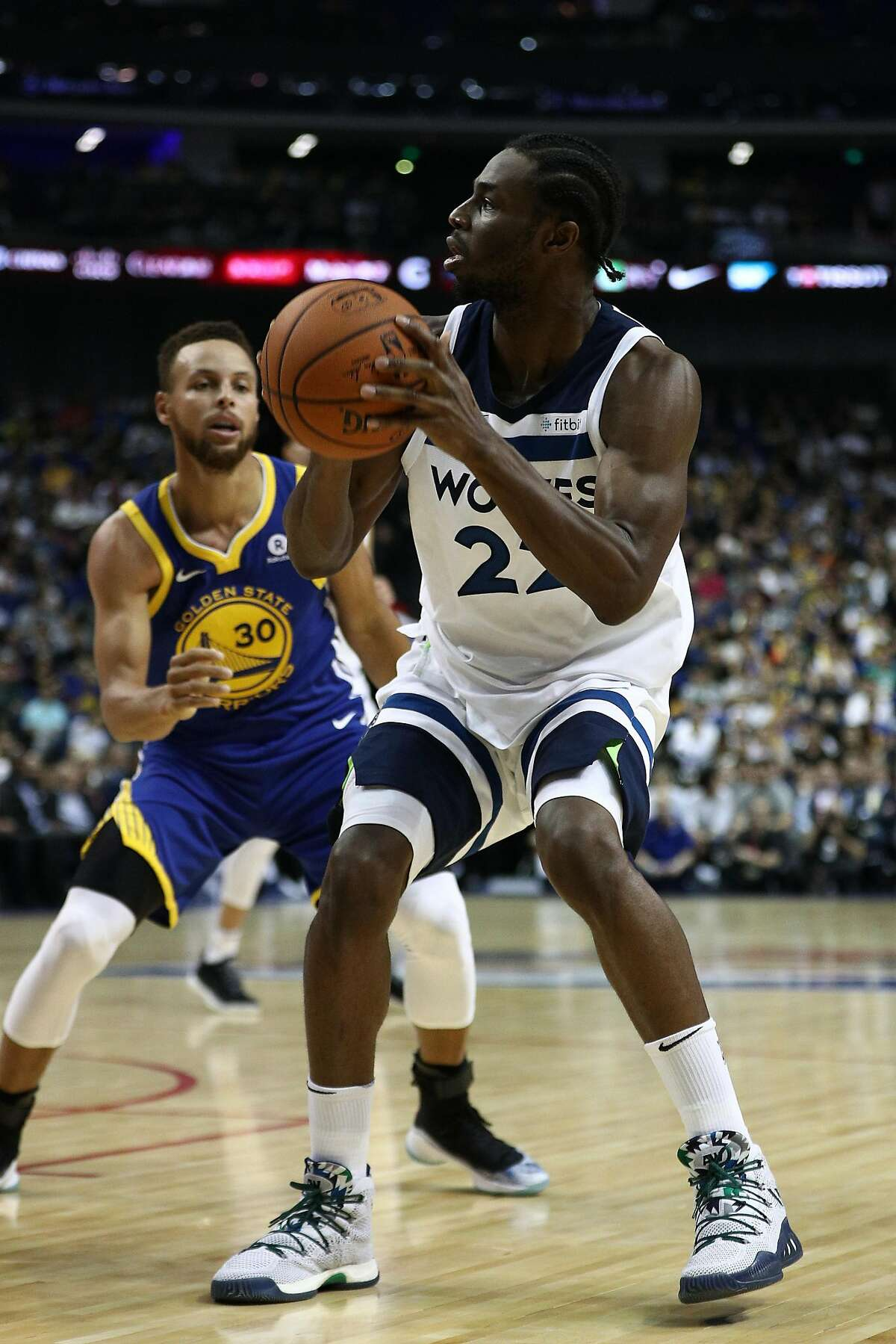 SHANGHAI, CHINA - OCTOBER 05: Andrew Wiggins #22 of the Minnesota Timberwolves in action against Stephen Curry #30 of the Golden State Warriors during the game between the Minnesota Timberwolves and the Golden State Warriors as part of 2017 NBA Global Ga