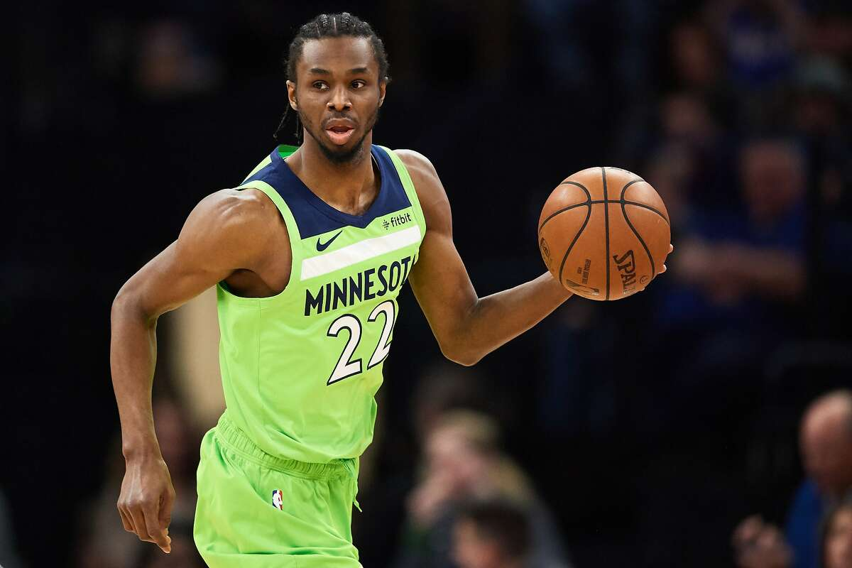 MINNEAPOLIS, MN - MARCH 30: Andrew Wiggins #22 of the Minnesota Timberwolves dribbles the ball against the Philadelphia 76ers during the game on March 30, 2019 at the Target Center in Minneapolis, Minnesota. NOTE TO USER: User expressly acknowledges and a