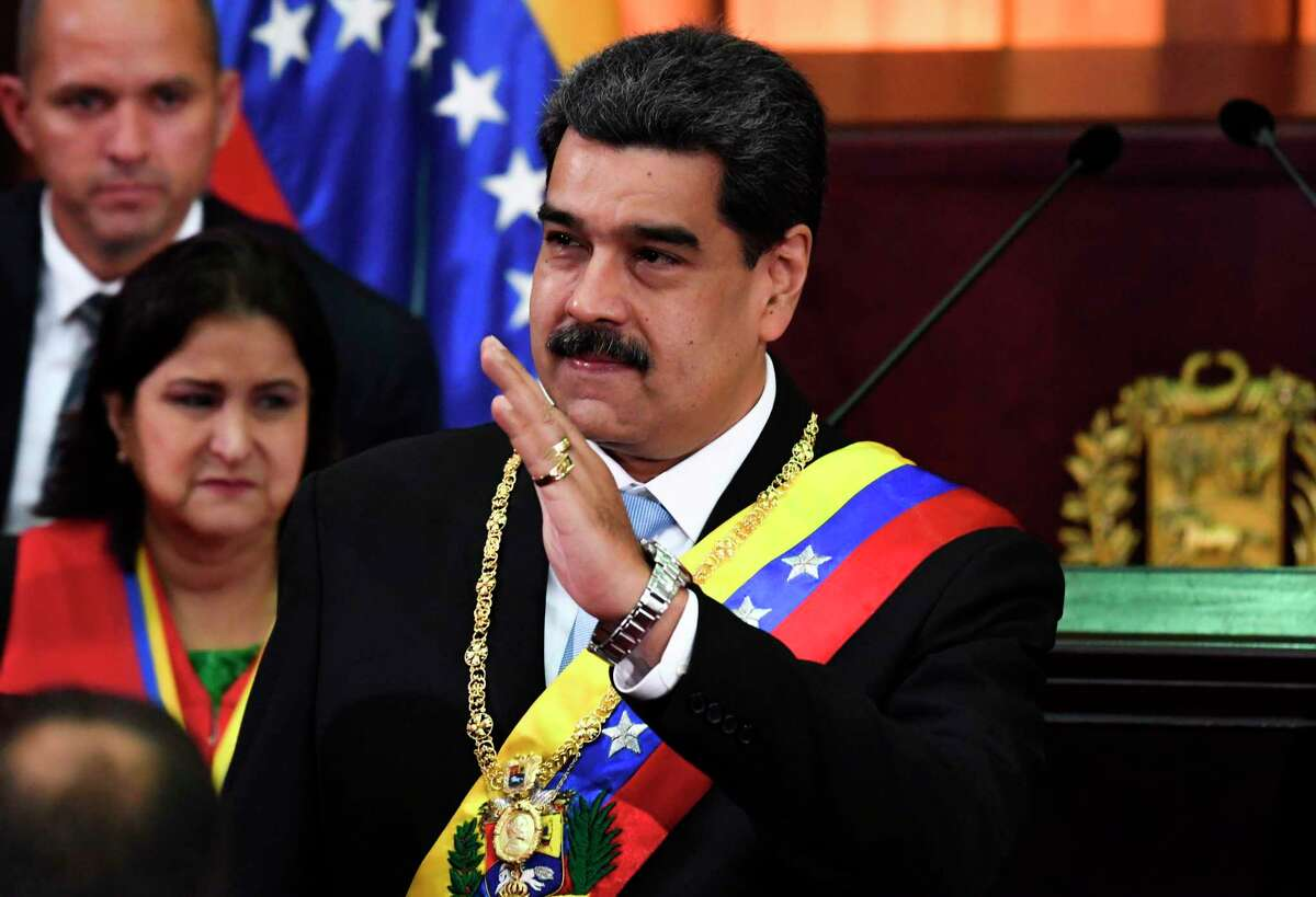 Venezuelan President Nicolas Maduro waves during the opening ceremony of the judicial year at the Supreme Court of Justice in Caracas, on January 31, 2020. (Photo by Yuri CORTEZ / AFP) (Photo by YURI CORTEZ/AFP via Getty Images)