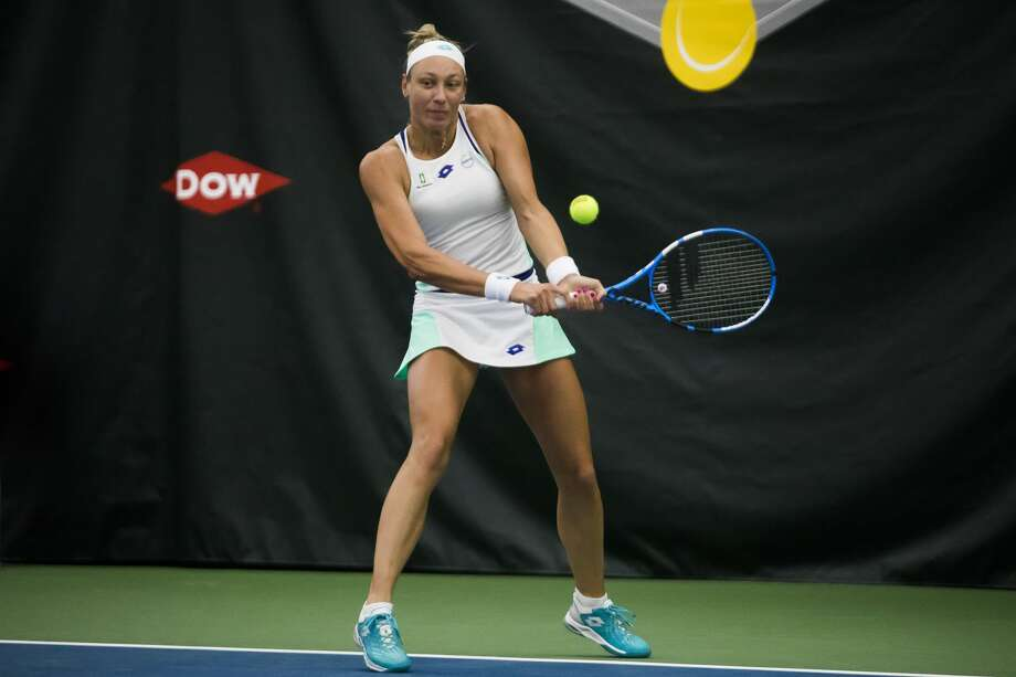 Belgium's Yanina Wickmayer returns a shot against Midland's Ellie Coleman on Tuesday at the Dow Tennis Classic. Wickmayer was one of three seeded players to win Thursday and advance to Friday's quarterfinals. Three other seeded players lost on Thursday. Photo: Katykildee/kildee@mdn.net