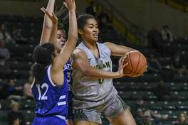 Midland College's Ella Tofaeono passes the ball as Western Texas College's Carrie Lacy and Kimberly Best guard her Thursday, Feb. 6, 2020 at Chaparral Center.