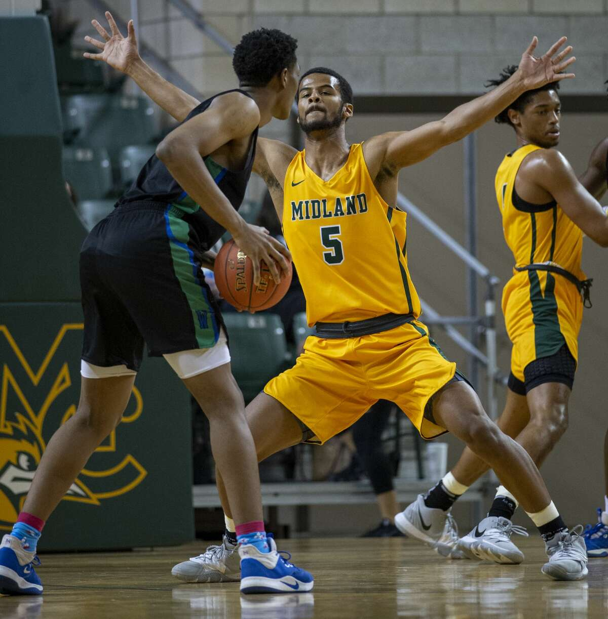 Midland College's Steven Richardson (5) guards Western Texas College's Donovan Reagan on Thursday, Feb. 6, 2020 at Chaparral Center.