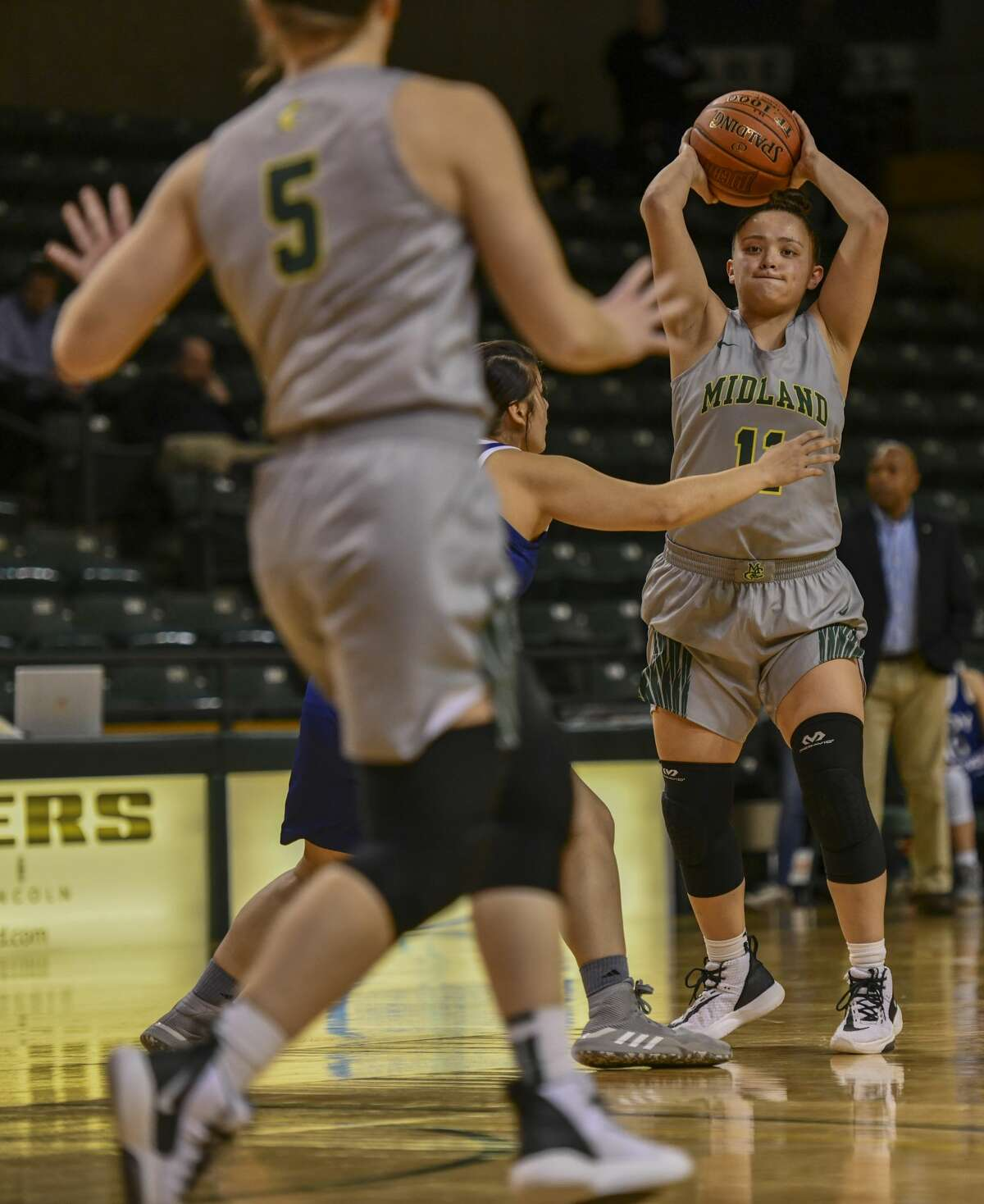 Midland College's Kayla Anderson looks to pass the ball to Grace Beasley as Western Texas College's Carrie Lacy guards her Thursday, Feb. 6, 2020 at Chaparral Center.