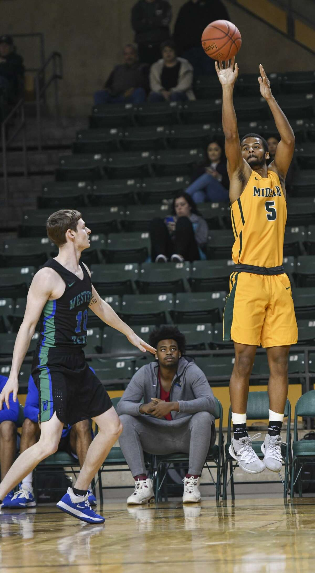 Midland College's Steven Richardson (5) shoots the ball as Western Texas College's Carson Hammond watches Thursday, Feb. 6, 2020 at Chaparral Center.