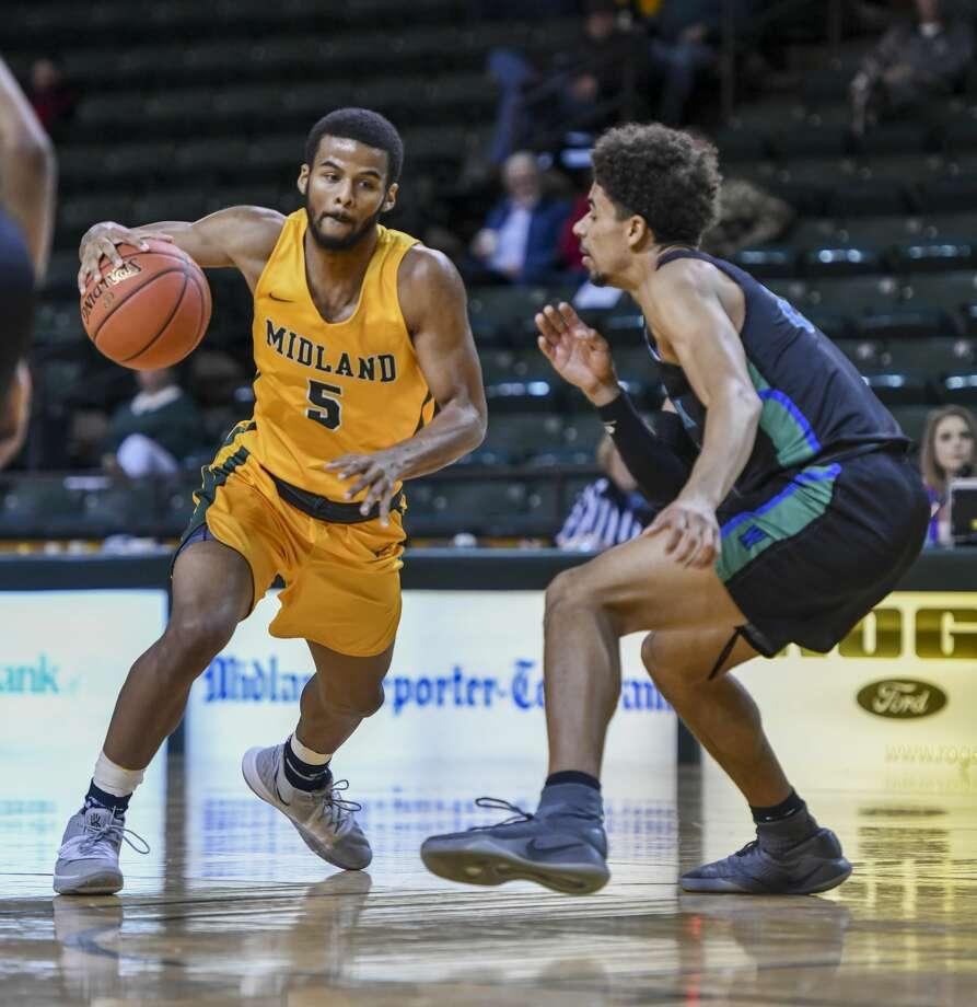 Midland College's Steven Richardson drives the ball against Western Texas College's Ben Smith on Thursday, Feb. 6, 2020 at Chaparral Center. Photo: Jacy Lewis/Reporter-Telegram
