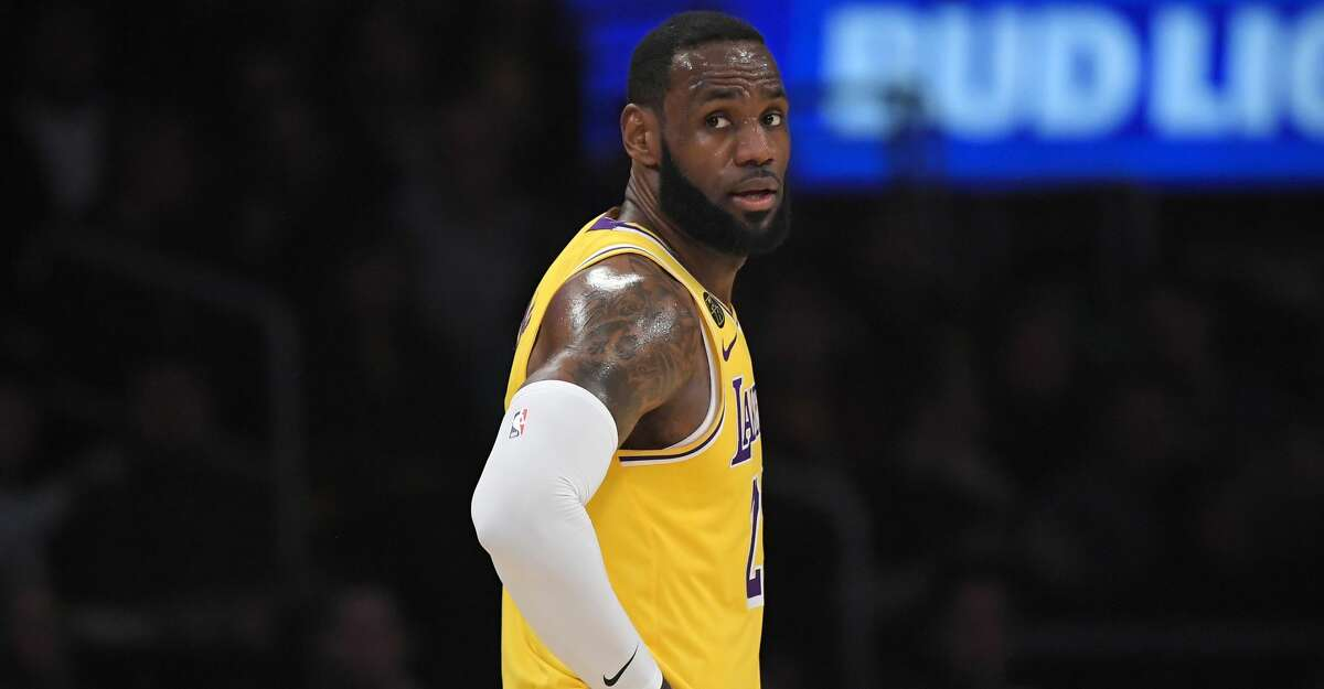 Los Angeles Lakers forward LeBron James stands on the court during the second half of an NBA basketball game against the San Antonio Spurs Tuesday, Feb. 4, 2020, in Los Angeles. The Lakers won 129-102. (AP Photo/Mark J. Terrill)