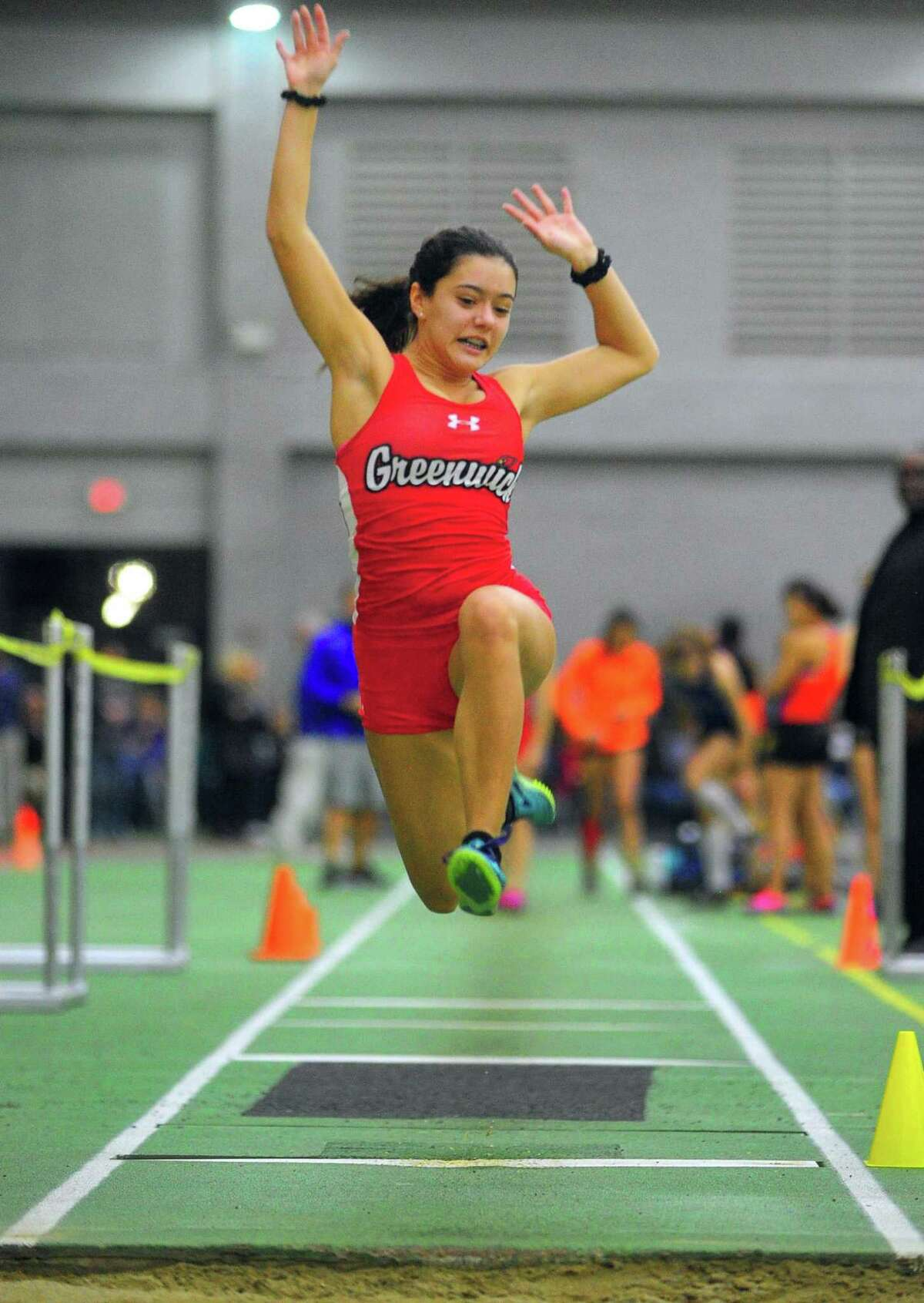 Greenwich's Caroline Carvalho competes in the long jump during the FCIAC Indoor Track and Field Championships on Thursday in New Haven. For complete coverage of the meet visit greenwichtime.com/sports.