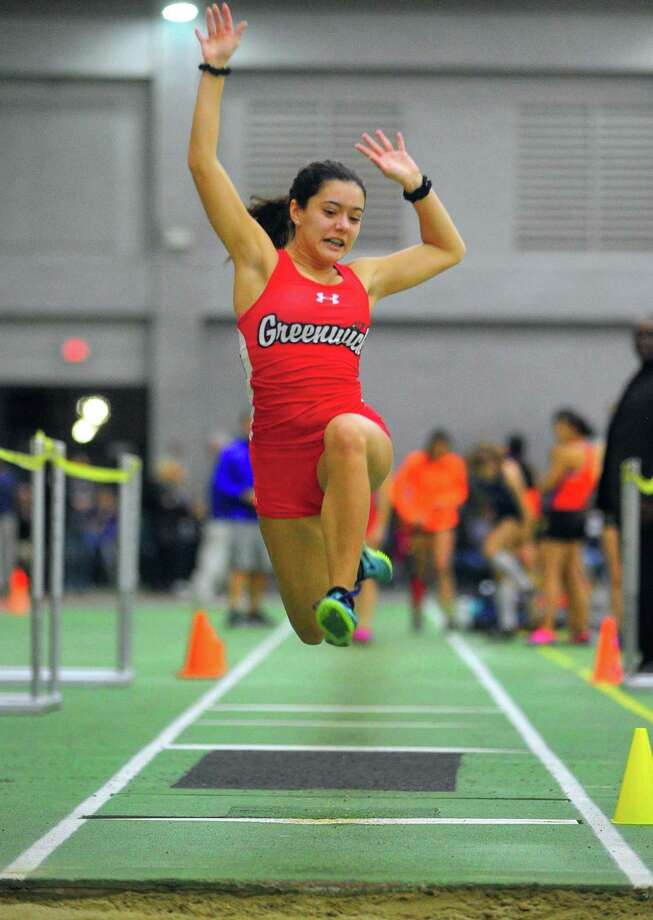 Greenwich's Caroline Carvalho competes in the long jump during the FCIAC Indoor Track and Field Championships on Thursday in New Haven. For complete coverage of the meet visit greenwichtime.com/sports. Photo: Christian Abraham / Hearst Connecticut Media / Connecticut Post
