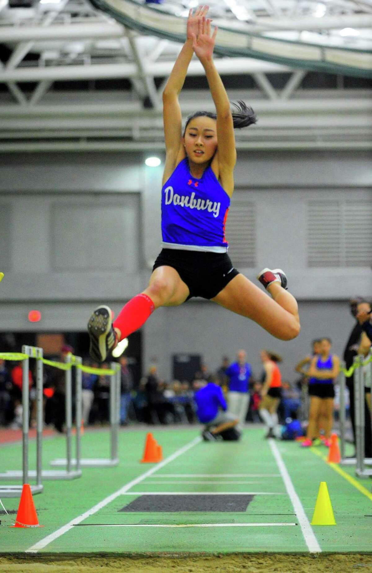 Danbury's Meilee Kry competes in the long jump during FCIAC Track Championship action in New Haven, Conn., on Thursday Feb. 6, 2020.