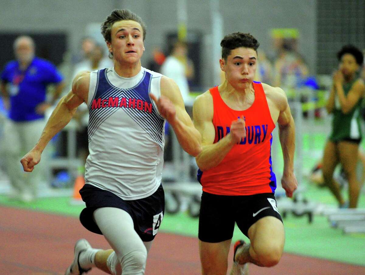Brien McMahon's Korey Morton, left, and Danbury's Jaden Cazorla compete in the 55 meter dash finals during FCIAC Track Championship action in New Haven, Conn., on Thursday Feb. 6, 2020.