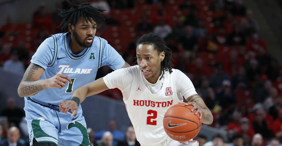 Houston Cougars guard Caleb Mills (2) drives around Tulane Green Wave guard K.J. Lawson (1) during the second half of an NCAA Men's basketball game at the Fertitta Center, in Houston, Thursday, Feb. 6, 2020. Photo: Karen Warren/Staff Photographer