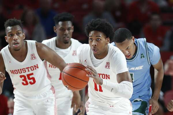 Houston Cougars guard Nate Hinton (11) on a fast break during the first half of an NCAA Men's basketball game at the Fertitta Center, in Houston, Thursday, Feb. 6, 2020.