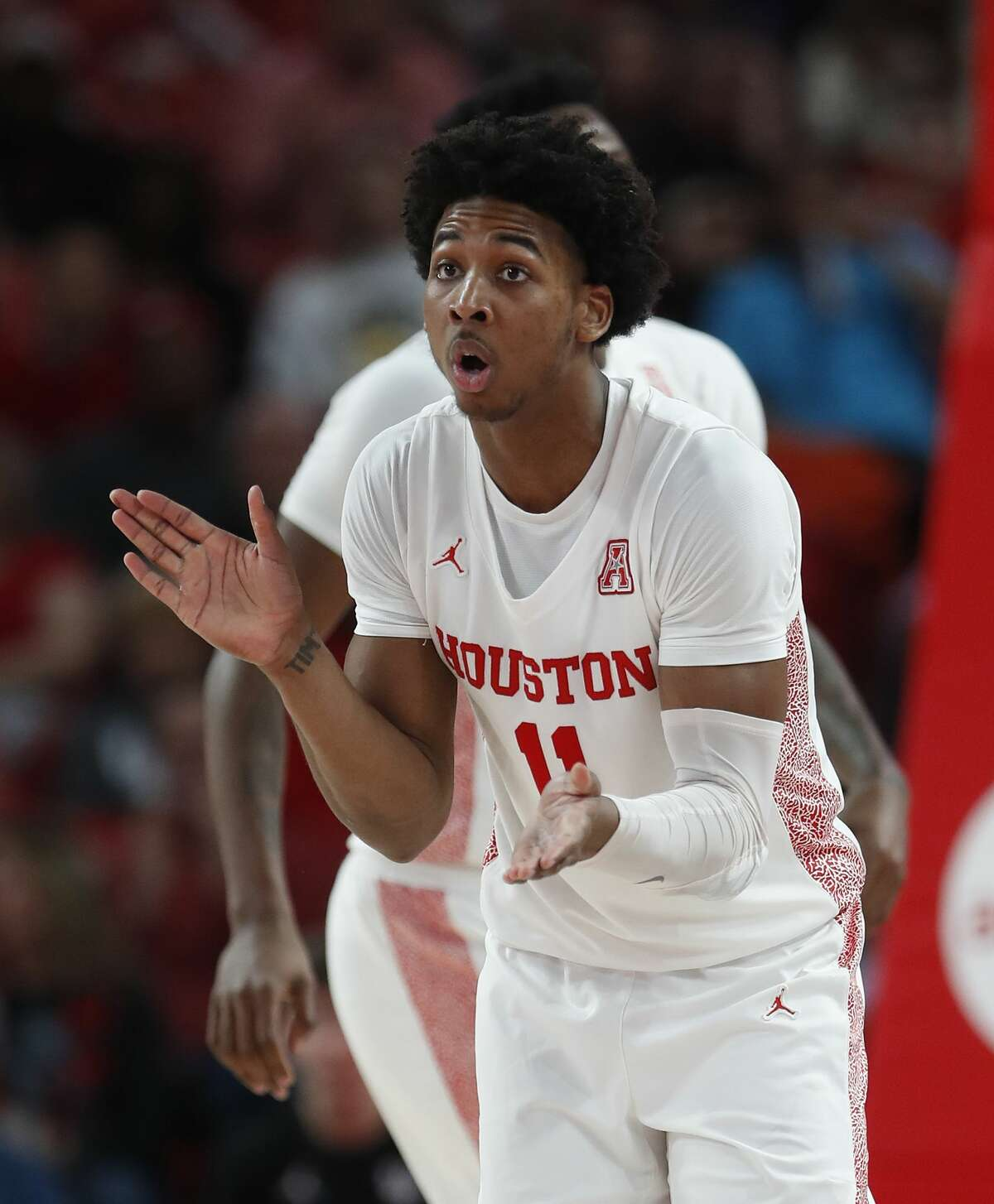 Houston Cougars guard Nate Hinton (11) reacts after a three-pointer during the second half of an NCAA Men's basketball game at the Fertitta Center, in Houston, Thursday, Feb. 6, 2020.