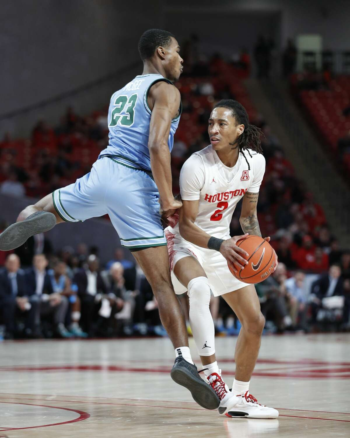 Houston Cougars guard Caleb Mills (2) stops as Tulane Green Wave guard R.J. McGee (23) nearly runs into him during the second half of an NCAA Men's basketball game at the Fertitta Center, in Houston, Thursday, Feb. 6, 2020.