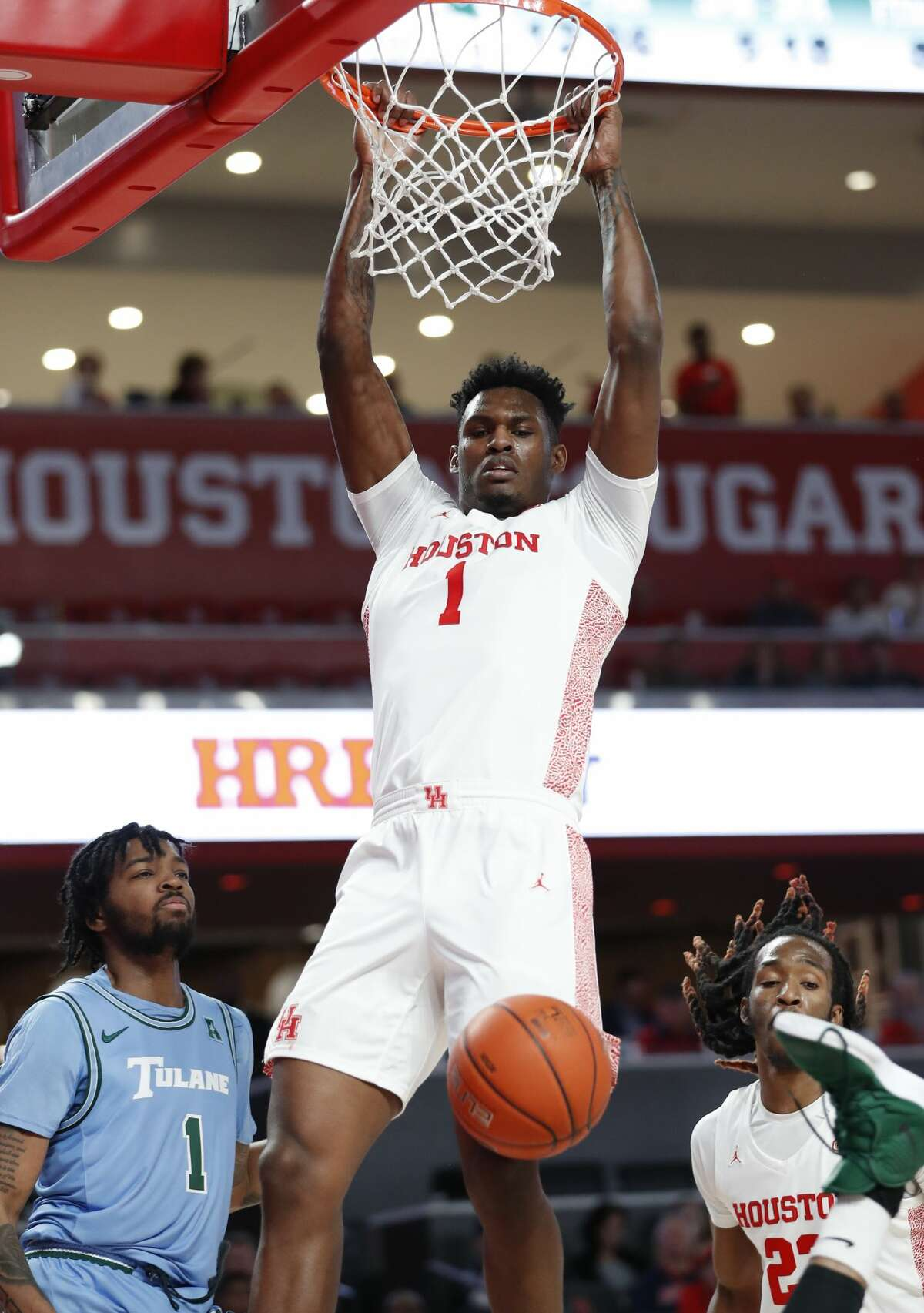 Houston Cougars center Chris Harris Jr. (1) dunks the ball against Tulane Green Wave during the second half of an NCAA Men's basketball game at the Fertitta Center, in Houston, Thursday, Feb. 6, 2020.