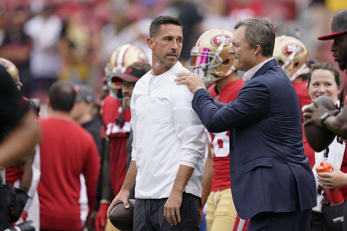 San Francisco 49ers head coach Kyle Shanahan, left, talks with general manager John Lynch before an NFL football game against the Pittsburgh Steelers in Santa Clara, Calif., Sunday, Sept. 22, 2019. (AP Photo/Tony Avelar)