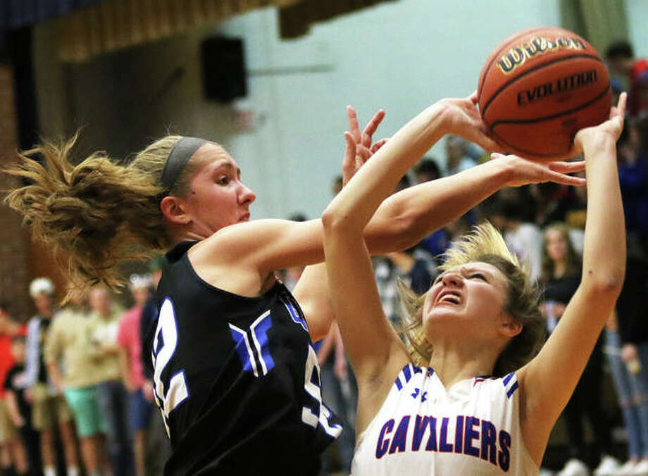 Carlinville's Jill Stayton (right) has her shot blocked by Greenville's Megan Hallemann during the first half of a SCC girls basketball game Thursday night in Carlinville. Stayton scored eight of her team-high 11 points in the fourth quarter to lead the Cavs to a victory. Photo: Greg Shashack / The Telegraph