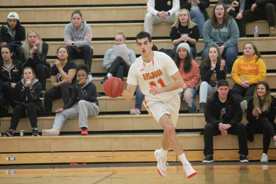 Ferris' Michael Peterson gets set to take the ball down court for the Bulldogs on Thursday against Saginaw Valley. (Pioneer photo/John Raffel)