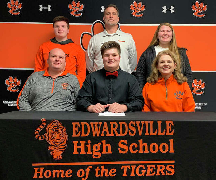 Edwardsville senior Reed Kaburick, seated center, will play college football at Central Missouri. He is joined in the picture by his family and EHS coach Matt Martin. Photo: Matt Kamp|The Intelligencer