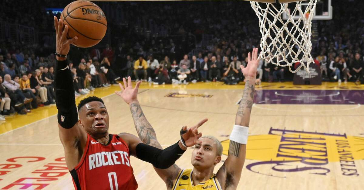 Houston Rockets guard Russell Westbrook, left, shoots as Los Angeles Lakers forward Kyle Kuzma defends during the first half of an NBA basketball game Thursday, Feb. 6, 2020, in Los Angeles. (AP Photo/Mark J. Terrill)