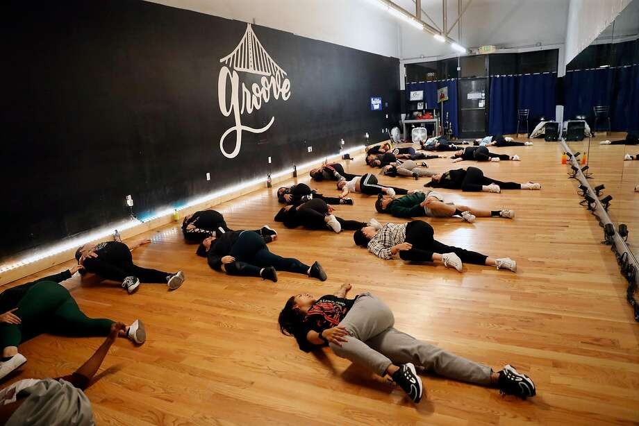 Dancers stretch and get in the groove, above, at the Oakland studio. Left: Panitchpakdi focused on dance full time about two years ago. Photo: Photos By Scott Strazzante / The Chronicle